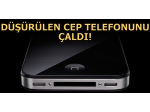 DÜŞÜRÜLEN CEP TELEFONUNU ÇALDI!